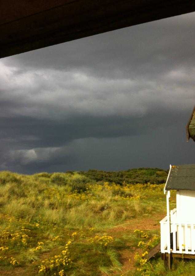 COMP Storms comin huts.jpeg