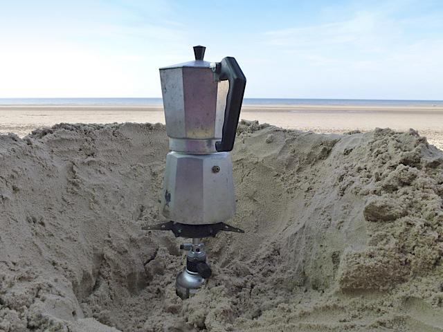Coffee pot on beach