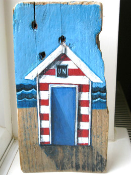 Sea-Glimpse's driftwood beach hut by Lizzie Spikes.