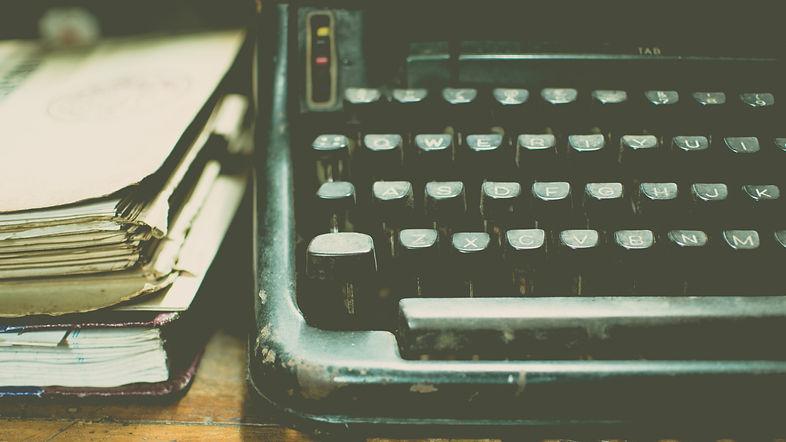 Vintage typewriter and notebooks