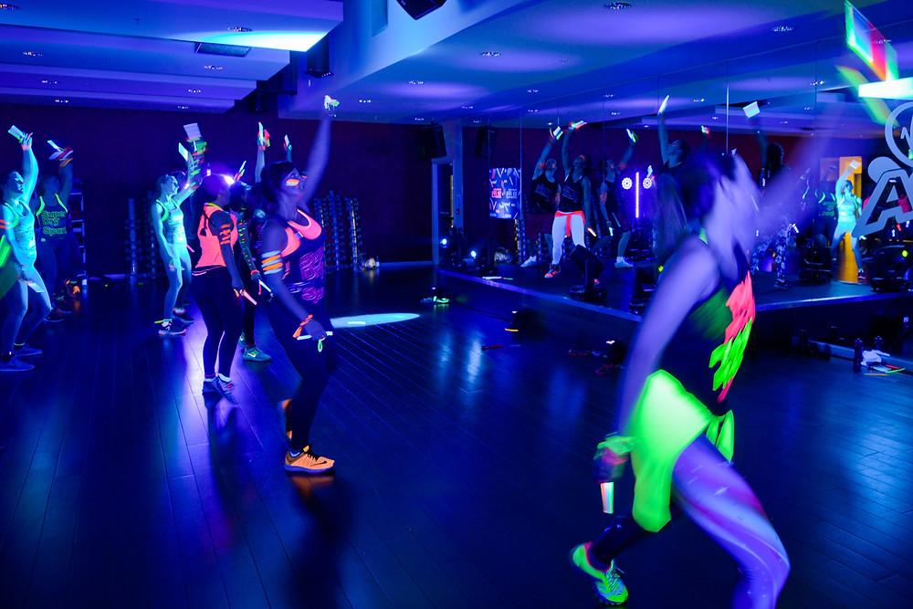 women dancing in the dark with glow sticks