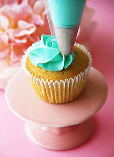 Piping buttercream cupcake