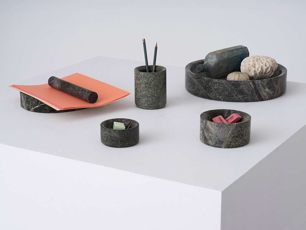 The new Lithic collection of desk accessories, trays, bowls, pencil holder, in green stone, designed by Studio Gorm for EQ3.