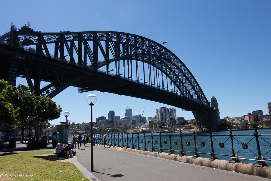Sydney Harbor Bridge view from walkway near bridge with Sydney city skyline behind