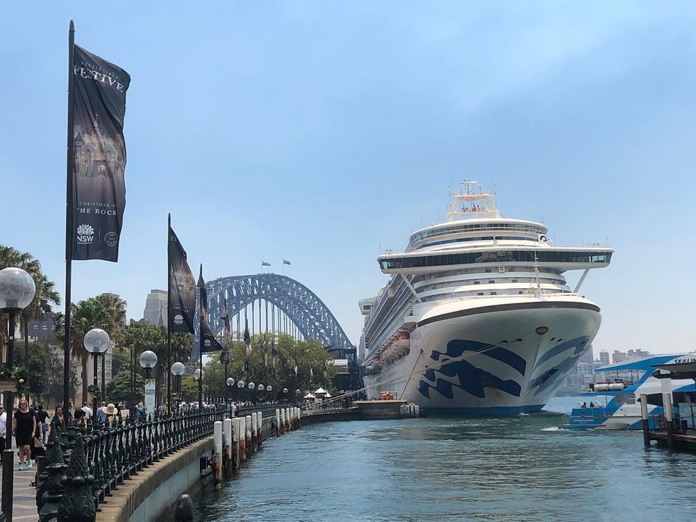 Circular Quay, Sydney Harbor, cruise ship, Sydney Harbor Bridge background with people walking