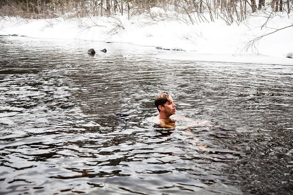 man in freezing water