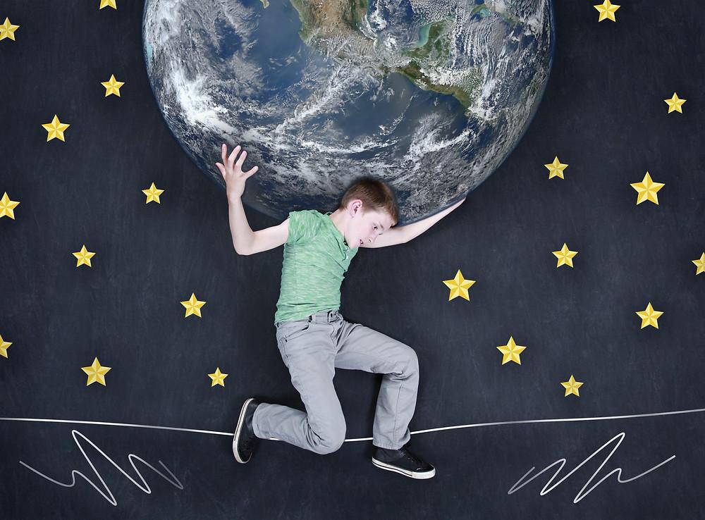 Boy holding up the world