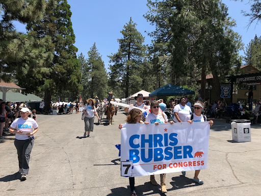 Chris marching in the Wrightwood Mountaineer Days Parade