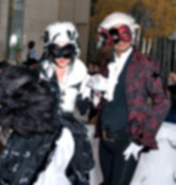 Masquerade stilt walkers