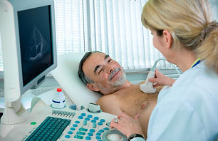 Doctor is using ultrasound machine to sc