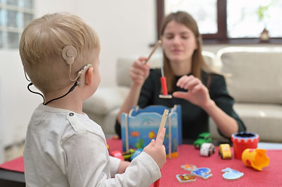 A Boy With A Hearing Aids And Cochlear I