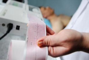 Electrocardiogram, ECG in hand. Clinic o