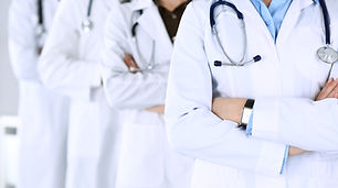 Group of modern doctors standing as a te
