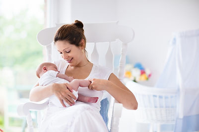 Young mother holding her newborn child.