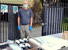 Jeff Thompson at front gate with masks a