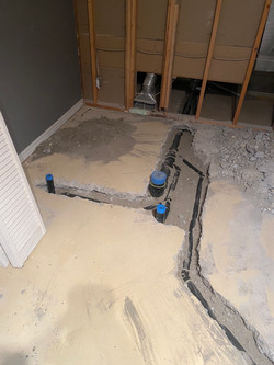 Plumbing groundwork for a basement suite.