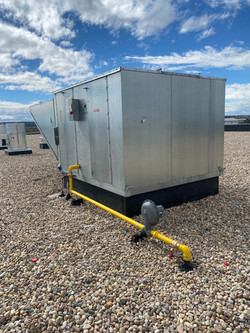 Gas line to roof top unit in manufacturing facility.