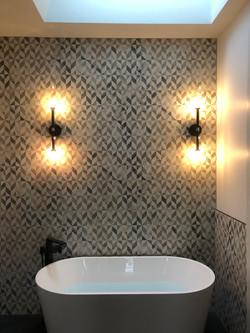 Freestanding tub and filler in new custom home.
