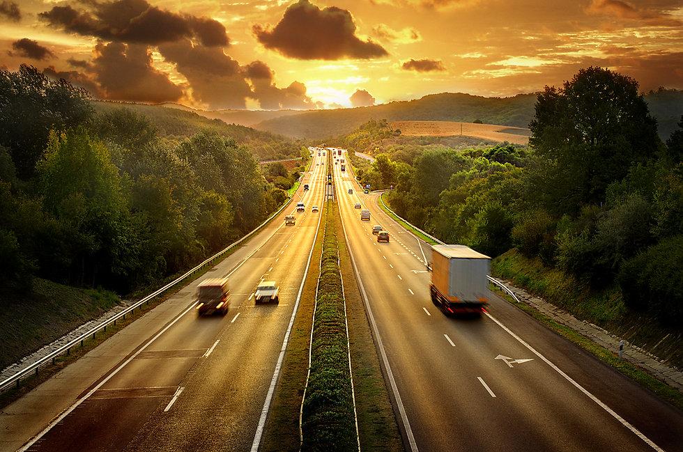Highway traffic in sunset.jpg