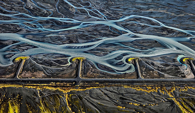 An aerial view of roads, mountains, and rivers