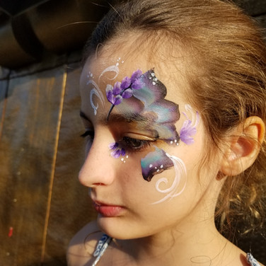 Butterfly with flowers face paint