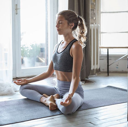 young-sporty-woman-practicing-yoga-royal