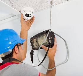 cctv engineer doing a emrgency alarm integration repair in nantwich