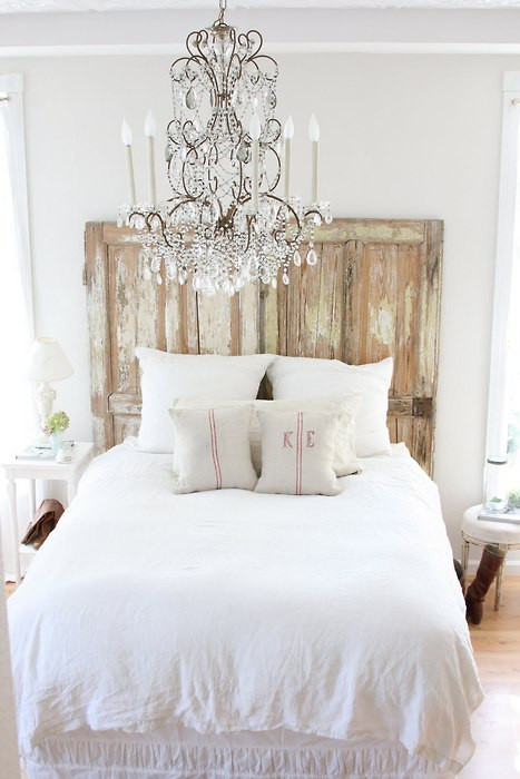 all-white-bedroom-rustic-chandelier-white-linen-bedding.jpg