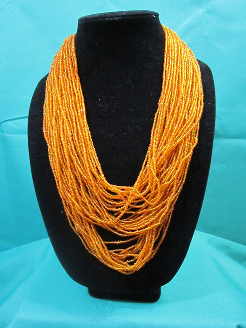 Multi strand orange necklace
