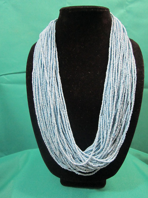 Multi-strand light blue necklace