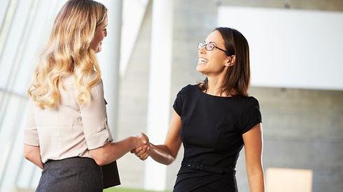 20150820184214-two-business-women-shakin