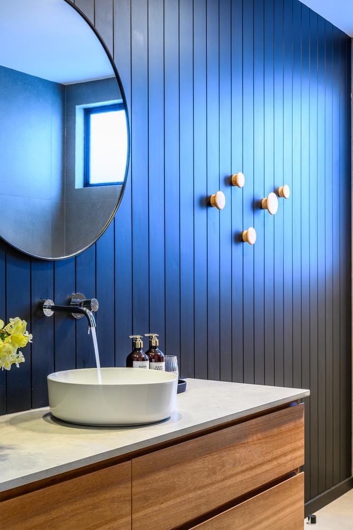 Allen Brothers Home blue walls bathroom.