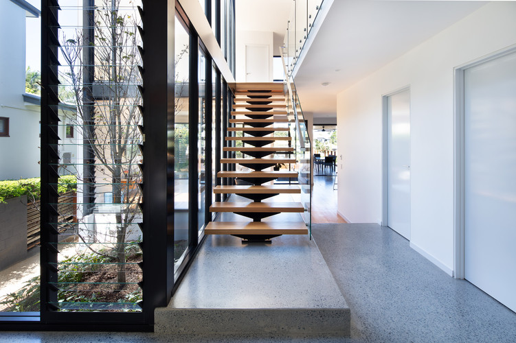 Timber stairs and polished concrete flooring