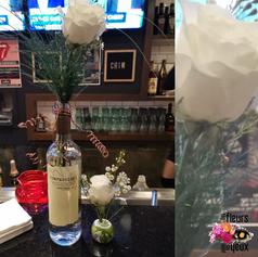 Rose et bouteille