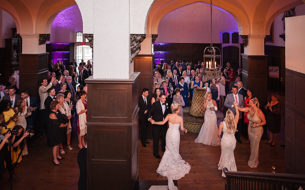 Wedding guests dancing inside Casa Loma at a wedding