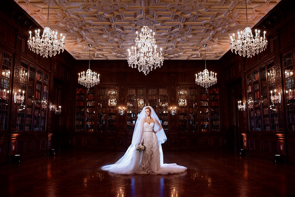 A bride standing inside Casa Loma during her wedding