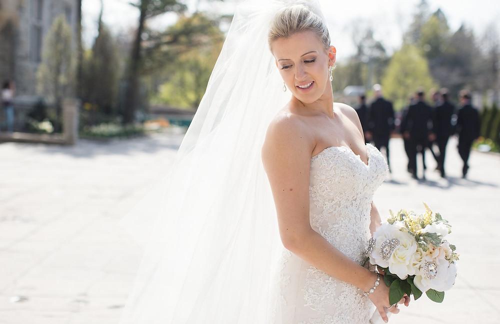 A bride in front of Casa Loma