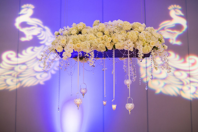 Floral-chandelier-crystals-peacock-gobo-