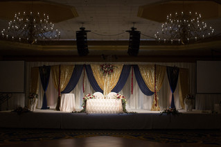 Sweetheart-table-gold-navy-draping-recep