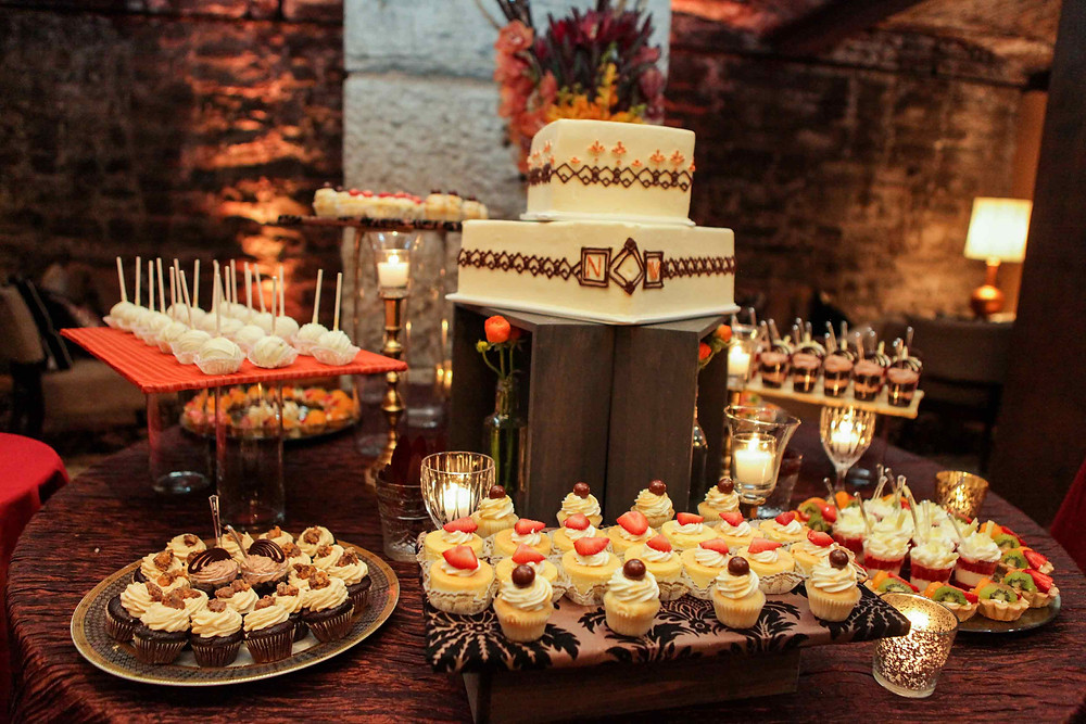 Wedding desserts with mini cupcake, shooters, cakepops, fruit tartlets, wedding cake, and art deco decor