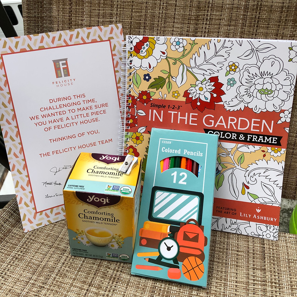 Photo of the care package contents: box of tea, coloring book, colored pencils, pencil sharpener, and a note from Felicity House