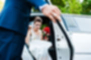 Wedding bride gets out of limousine
