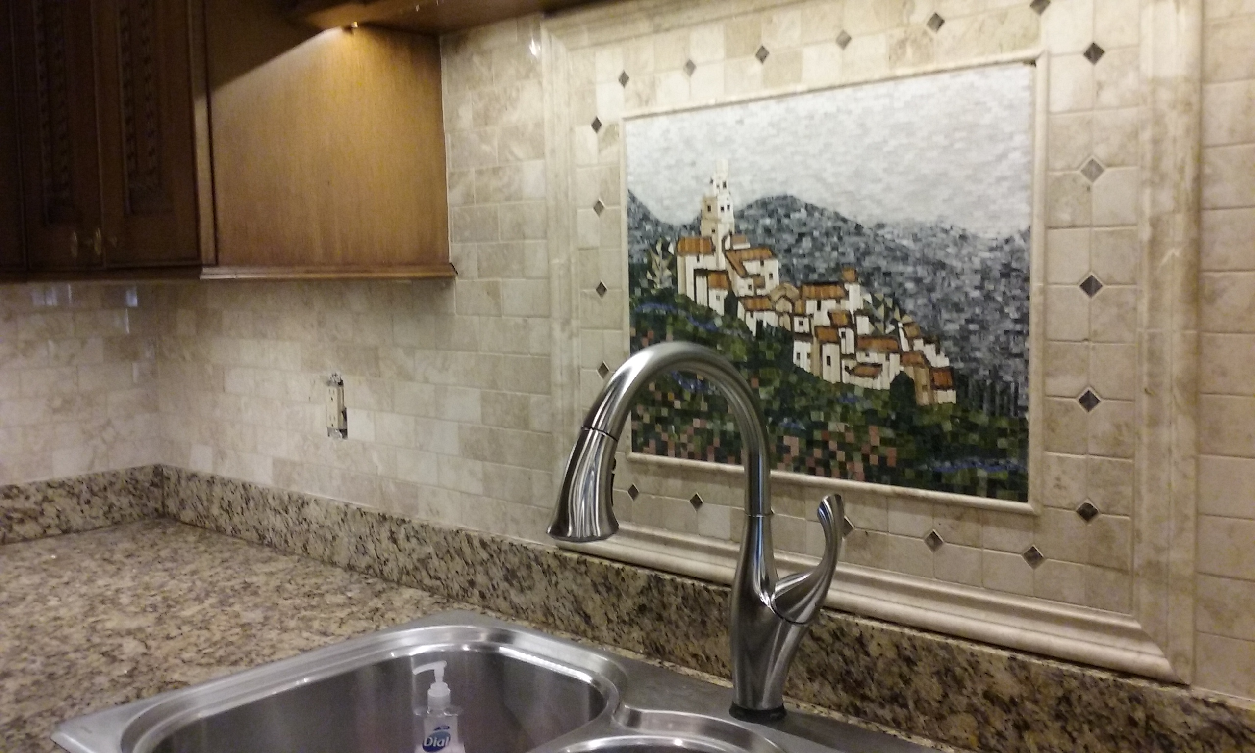 tumbled travertine and Tuscan mosaic
