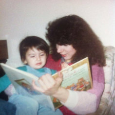 Mum reading 3 year old Mary-Anne a story...