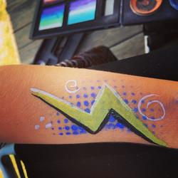 Instagram - Her volleyball team logo was the lighting #epicbodypaintATX #Facepai