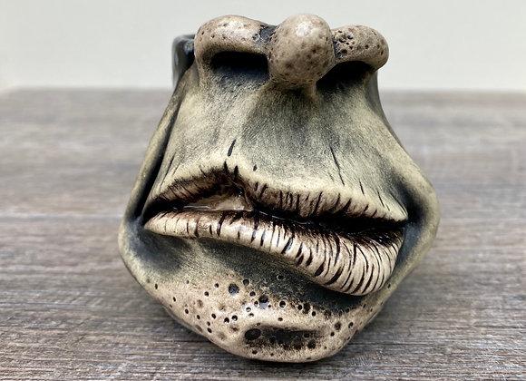 Face mug with black crystals glaze