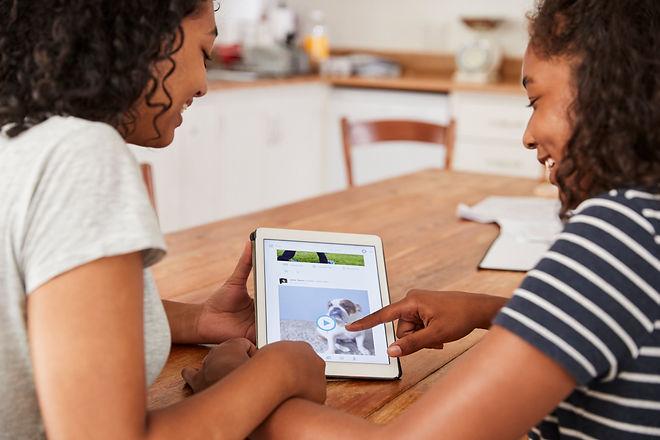 two-teenage-girls-using-social-media-on-