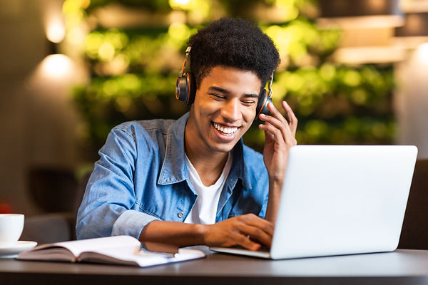 cheerful-teen-guy-with-headset-looking-a