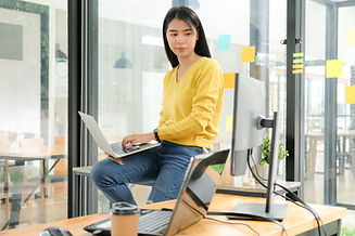 female-programmer-are-using-laptop-to-pl