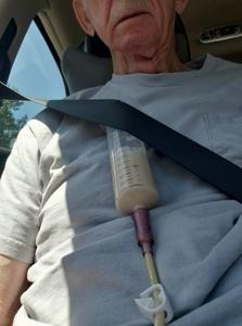 Man tube feeding in the car